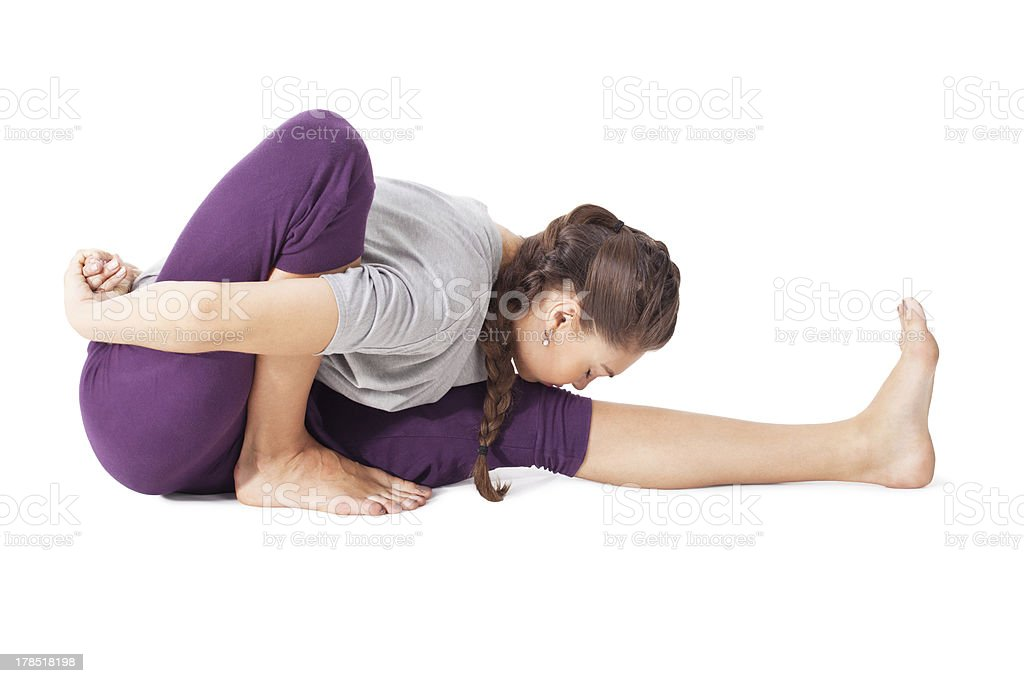 Young woman doing yoga Pose Dedicated to the Sage Marichi stock photo
