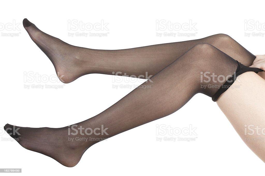 Young woman donning black panties stock photo