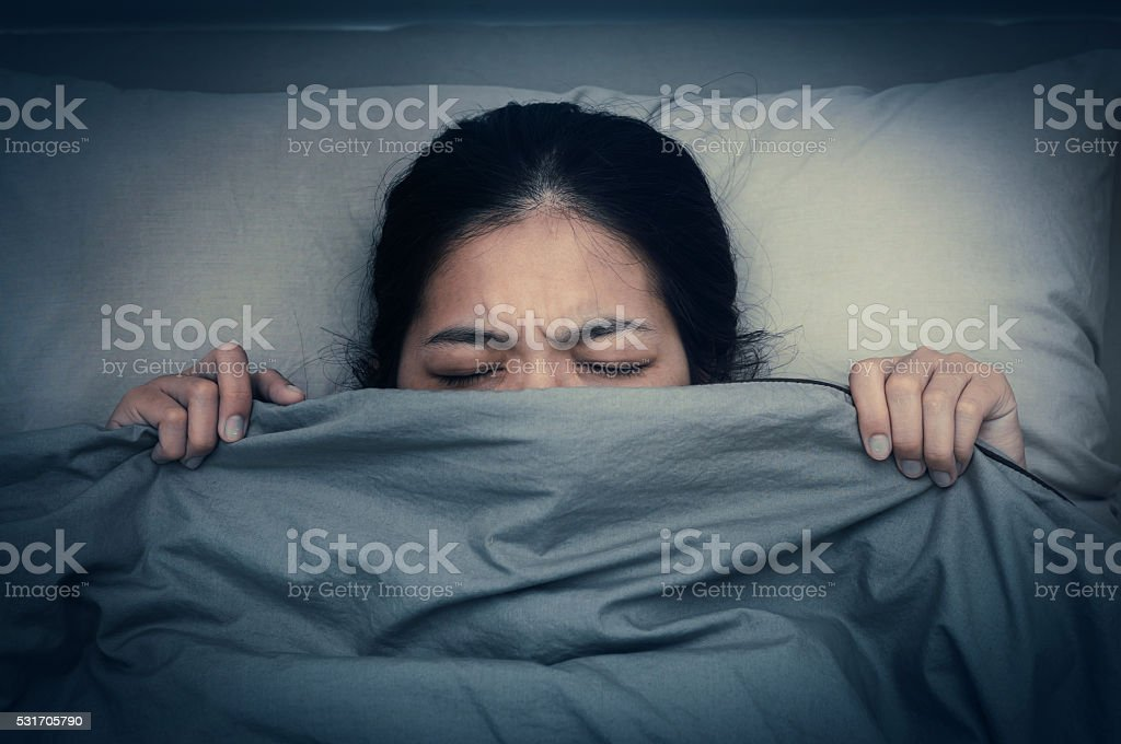 Young woman dont want to hear sound from alarm clocks. stock photo