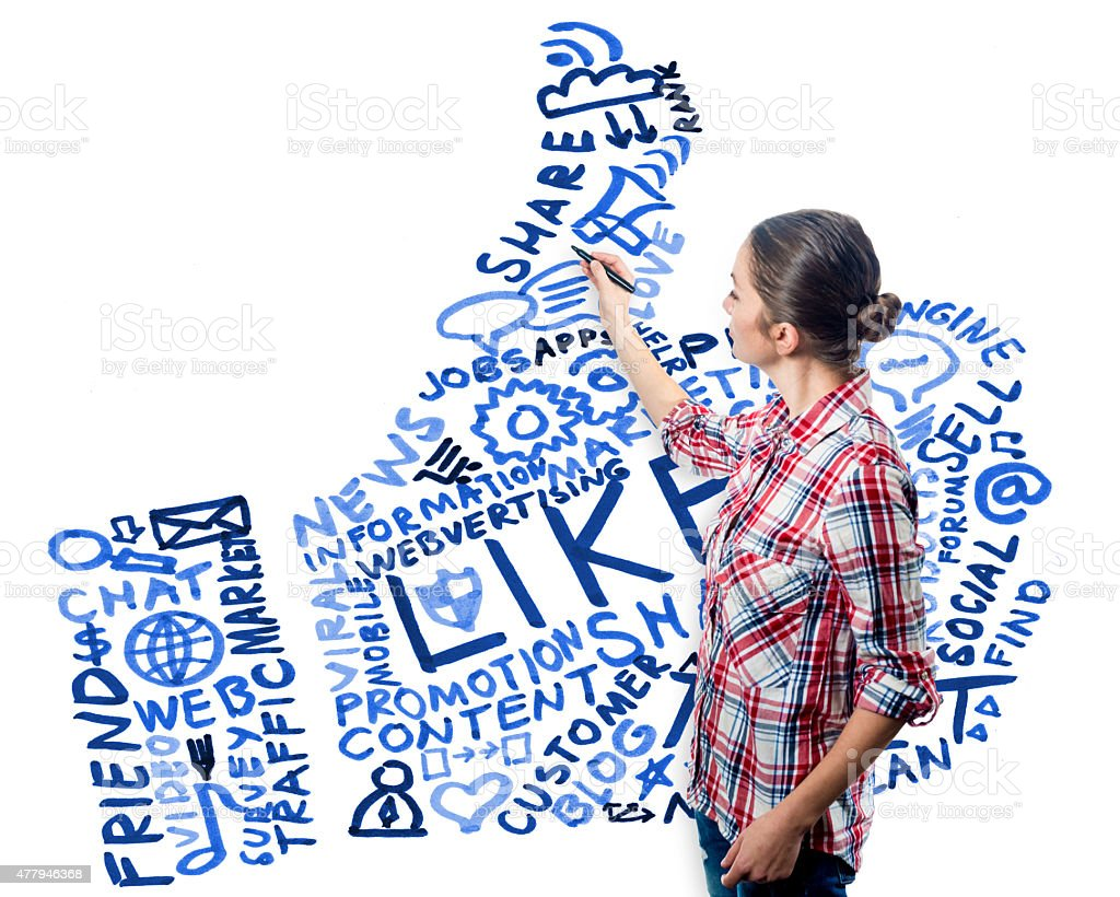 young woman drawing the thumbs up symbol stock photo