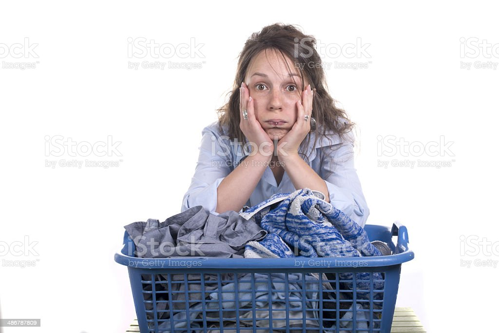 Young woman dreading doing her ironing stock photo