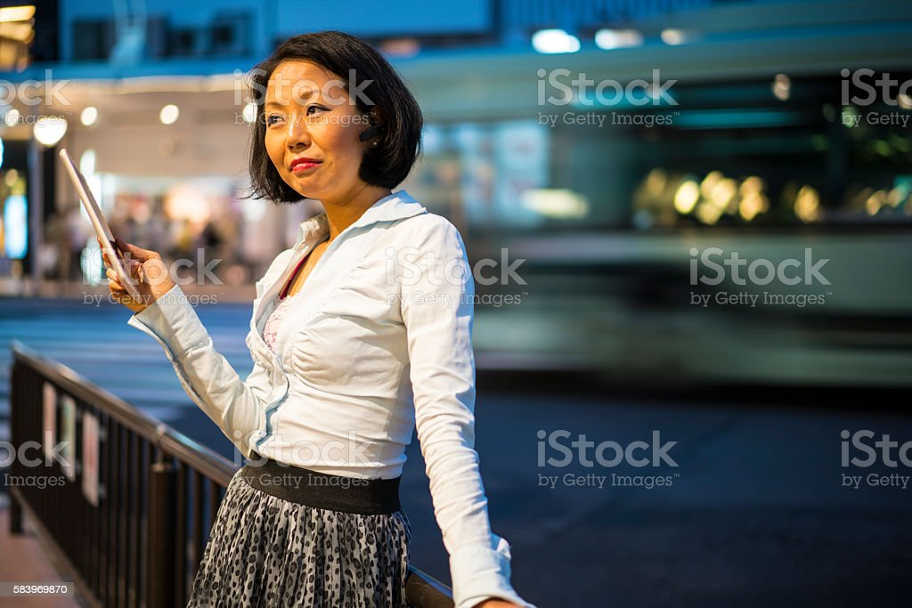 Young woman dreaming of  Gaming on street in Kyoto, Japan stock photo