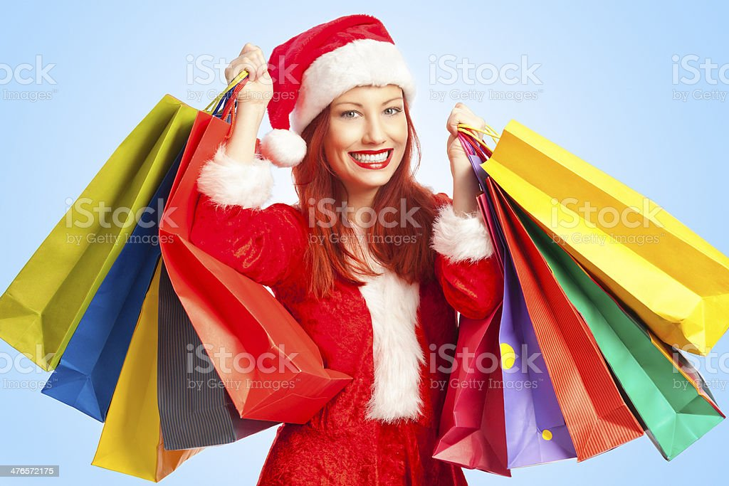 Young woman dressed as Santa's helper returning from shopping royalty-free stock photo