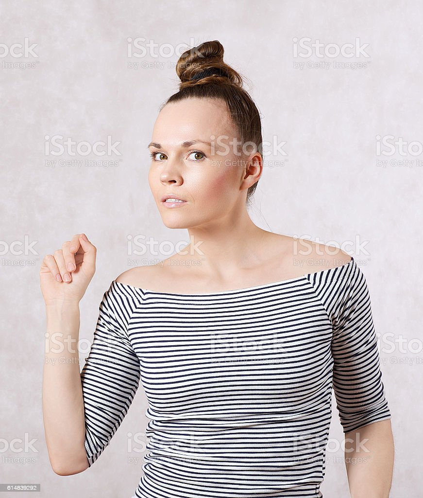 Young woman dressed in a white gray shirt. stock photo