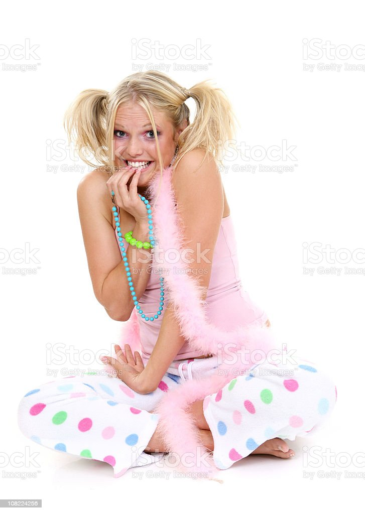 Young Woman Dressed in Colorful Pajamas on White Background royalty-free stock photo