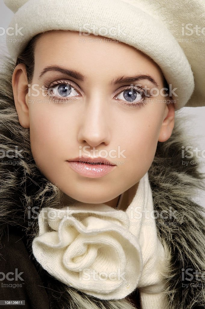 Young Woman Dressed in Scarf and Hat royalty-free stock photo