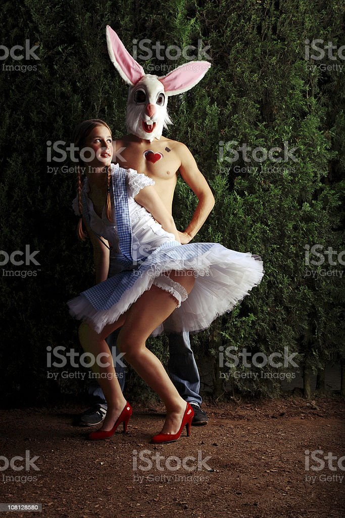 Young Woman Dressed Up Near Man In Bunny Costume royalty-free stock photo
