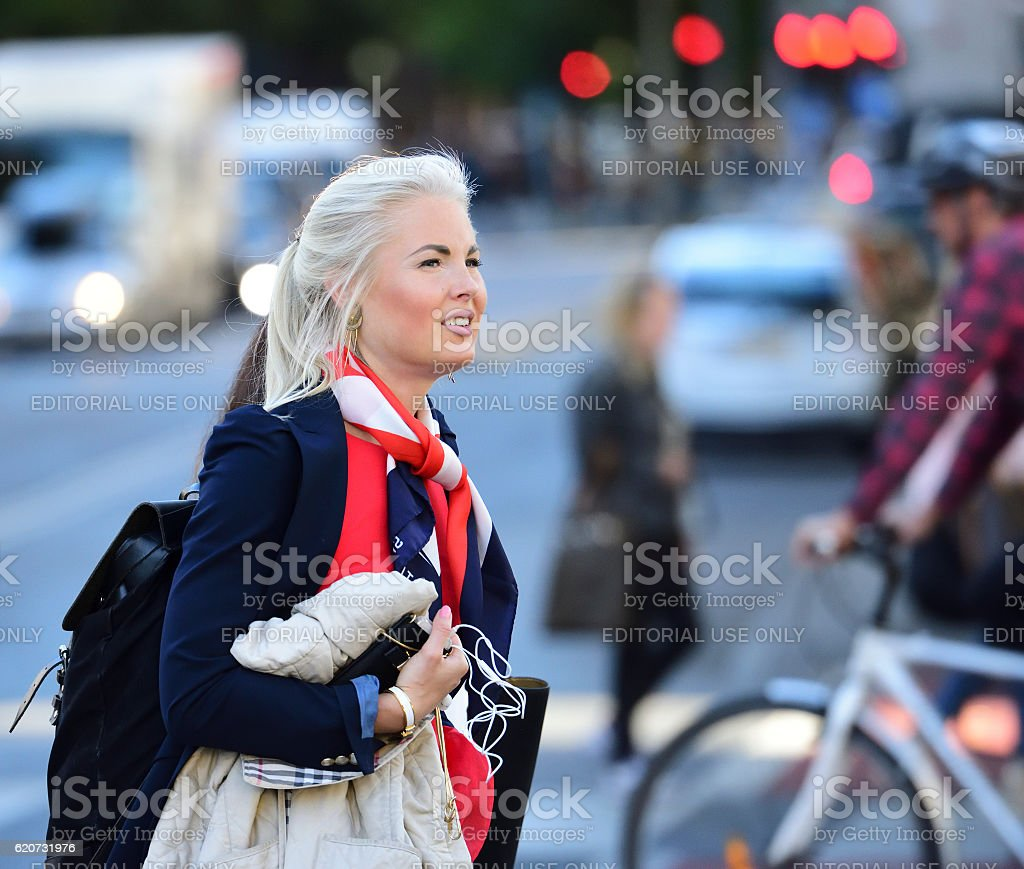 Young woman, dressed very British, on street stock photo