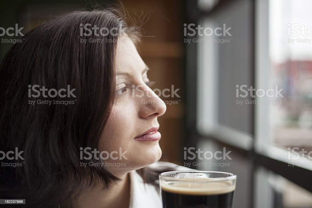Young Woman Drinking a Pint of Stout royalty-free stock photo