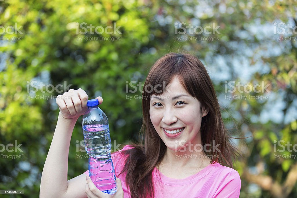 Young woman drinking bottled water After Hiking royalty-free stock photo