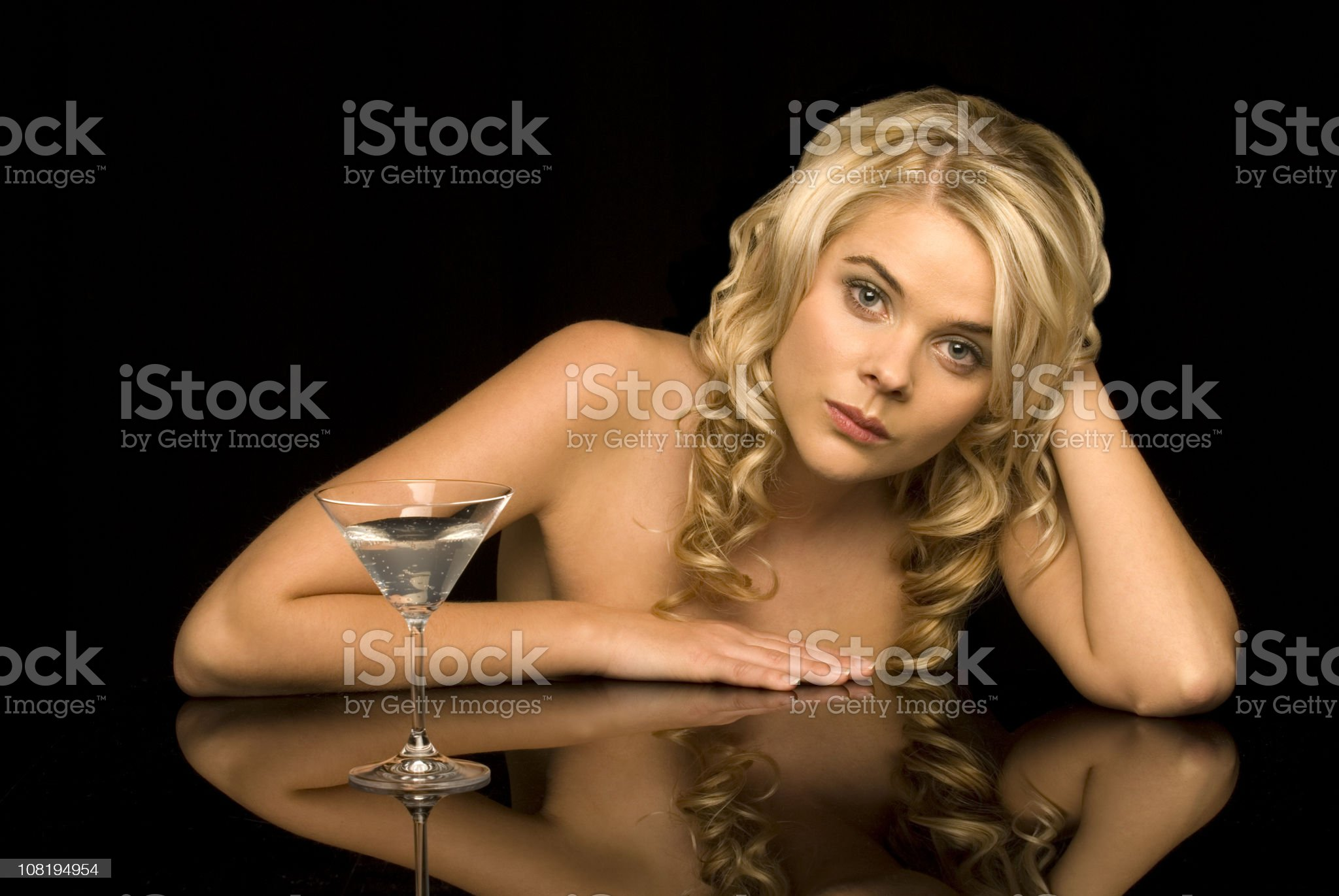 Young Woman Drinking Cocktail royalty-free stock photo
