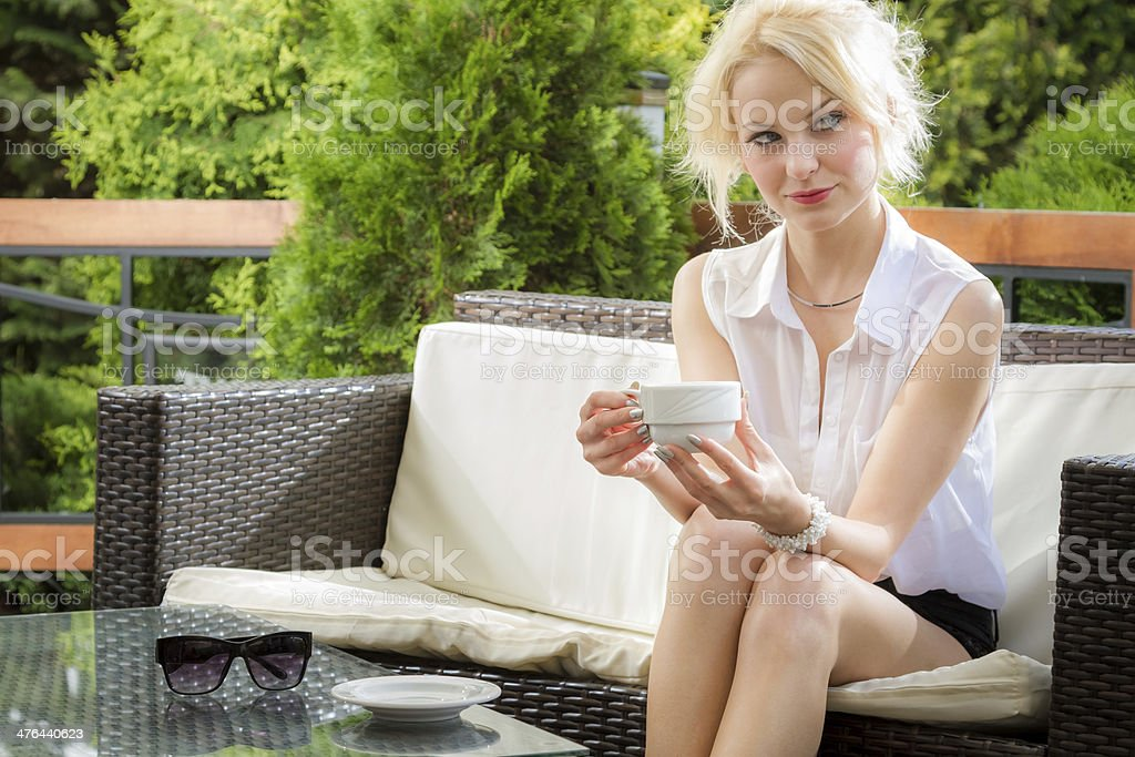Young woman drinking coffee in a restaurant royalty-free stock photo