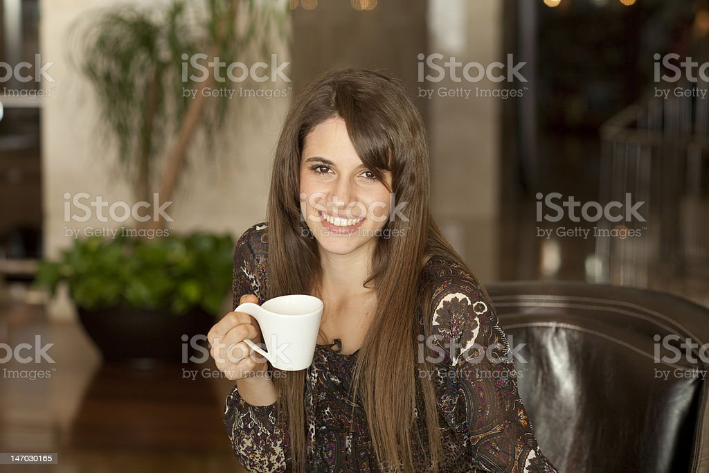 Young woman drinking coffee royalty-free stock photo