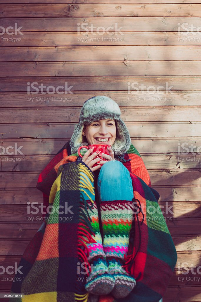 Young woman drinking hot coffee or tea at the  terrace stock photo