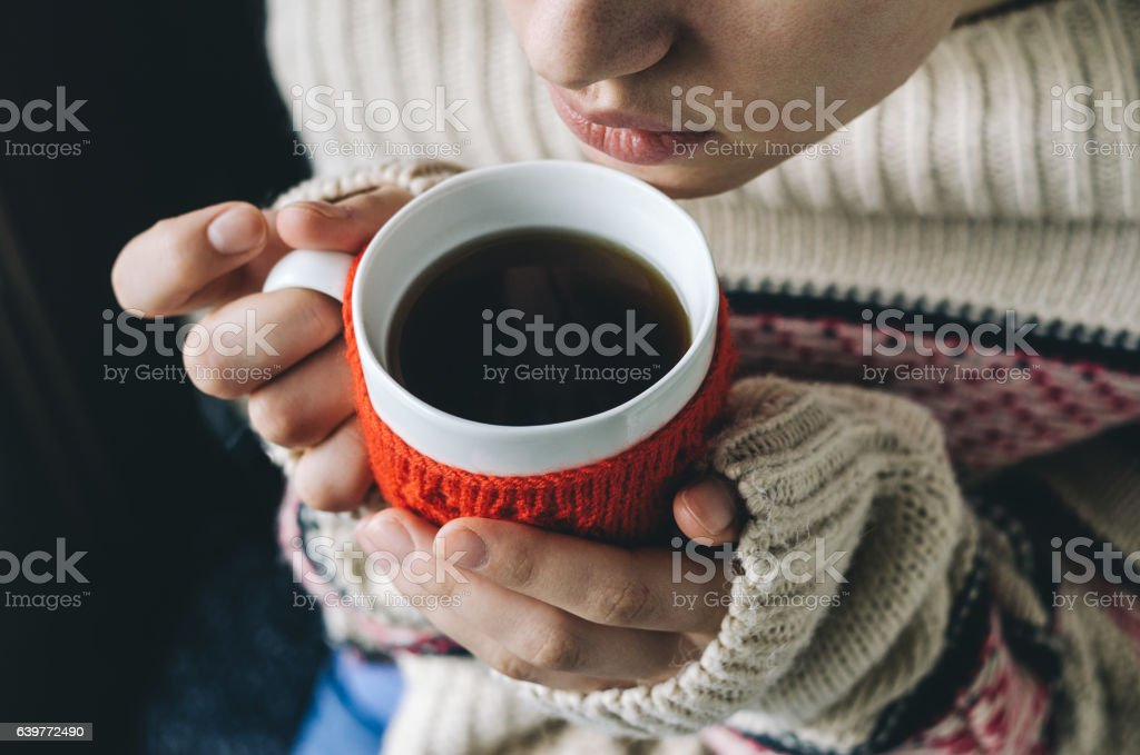 Young woman drinking hot coffee stock photo