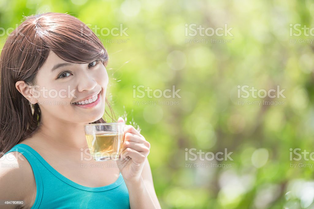 Young Woman drinking hot tea stock photo