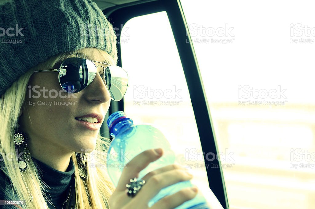 Young Woman Drinking in a Car royalty-free stock photo