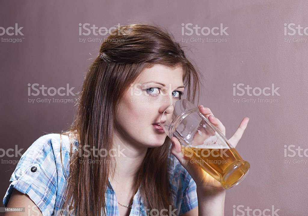 young woman drinking lager royalty-free stock photo