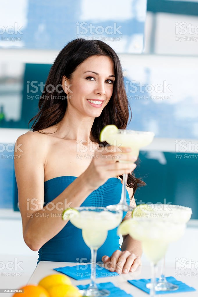 Young woman drinking margarita stock photo