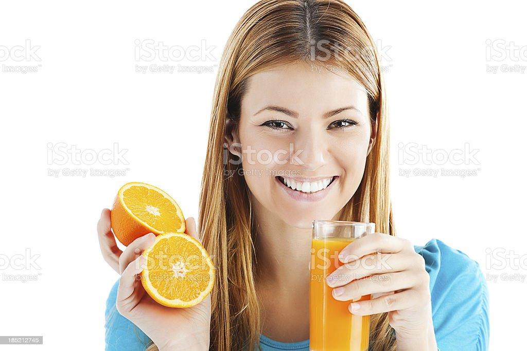 Young woman drinking orange juice. stock photo