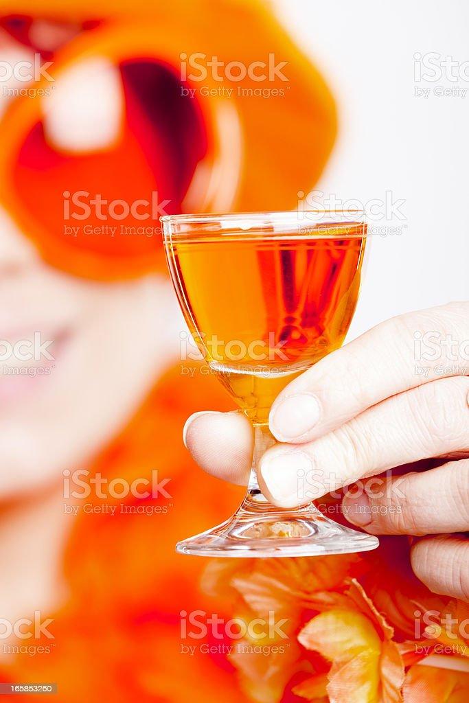 Young woman drinking Oranjebitter stock photo