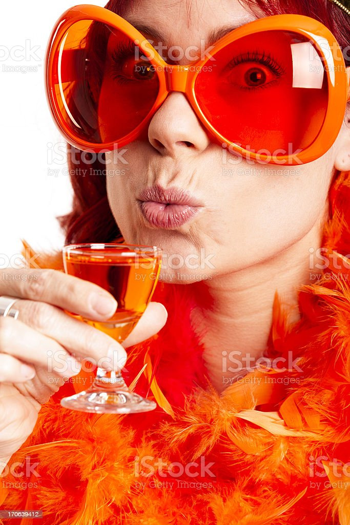 Young woman drinking Oranjebitter stock photo