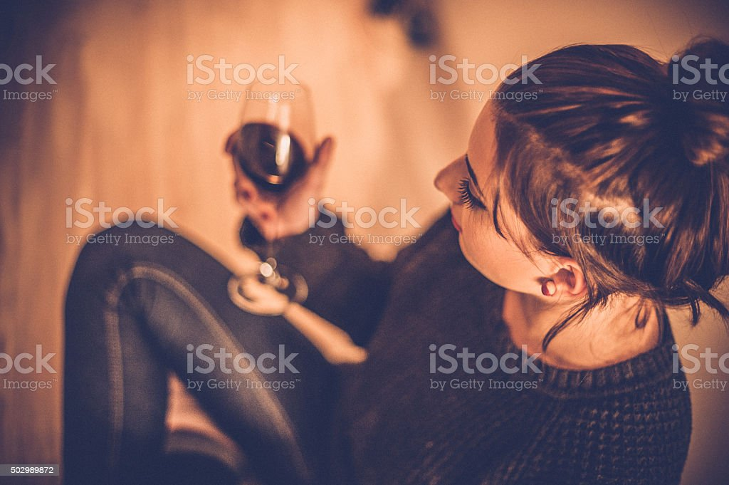 Young Woman Drinking Red Wine stock photo