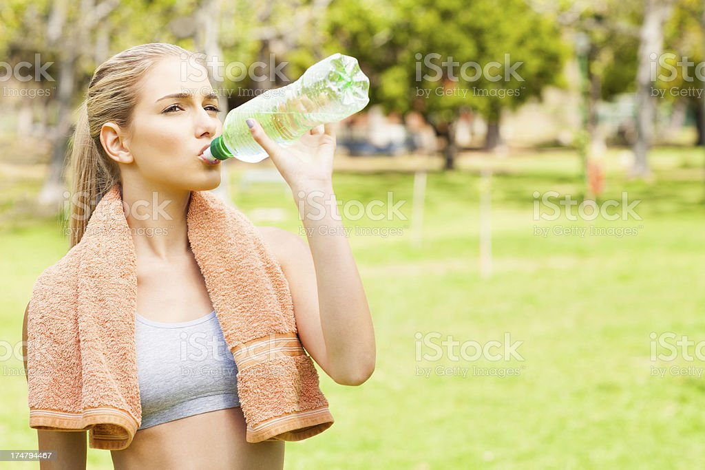 Young Woman Drinking Water After Exercising royalty-free stock photo