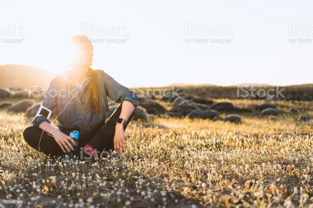 Young woman drinking water after workout stock photo