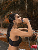 young woman drinking water during exercise at istanbul turkey
