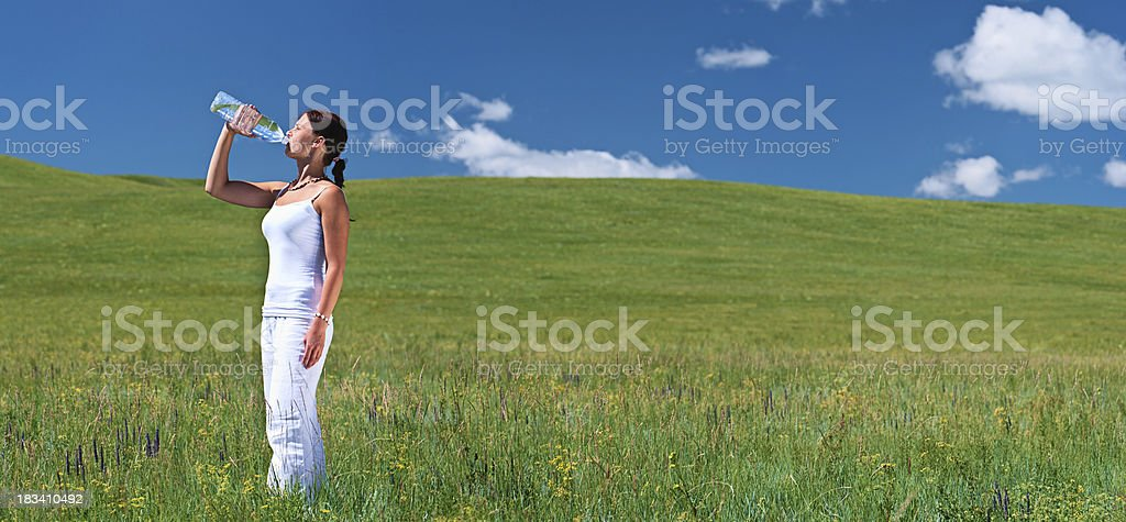 Young woman drinking water royalty-free stock photo