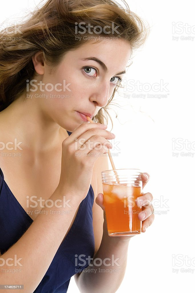 Young woman drinking with a straw stock photo