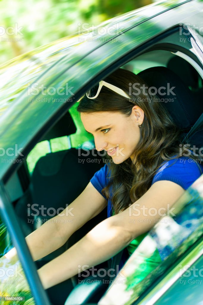Young woman driving a car royalty-free stock photo