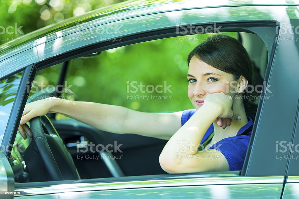 Young woman driving a car stock photo
