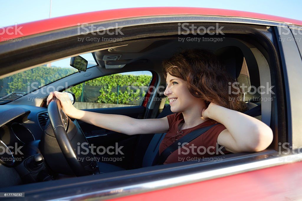 young woman driving a new car stock photo