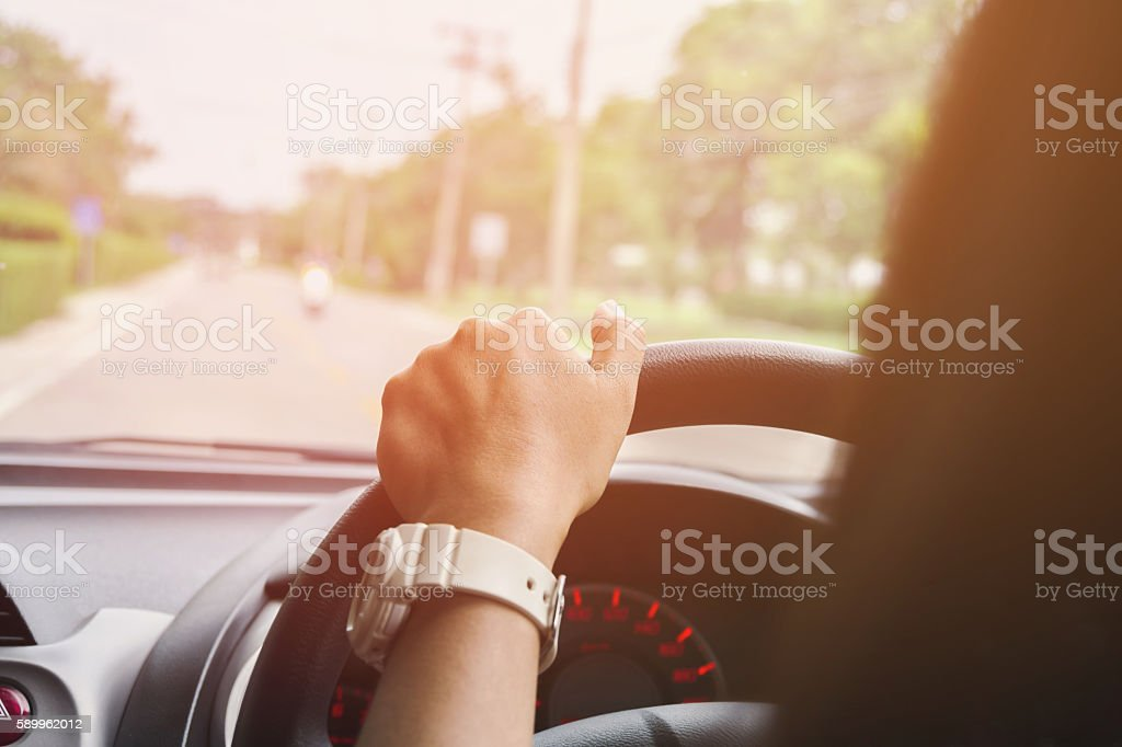 Young woman driving car stock photo