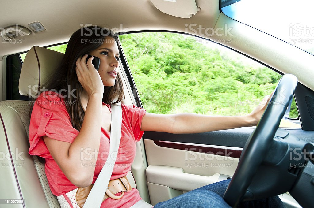 Young Woman Driving Car Using Phone royalty-free stock photo