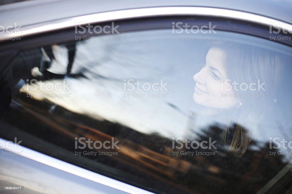 Young woman driving her car. stock photo
