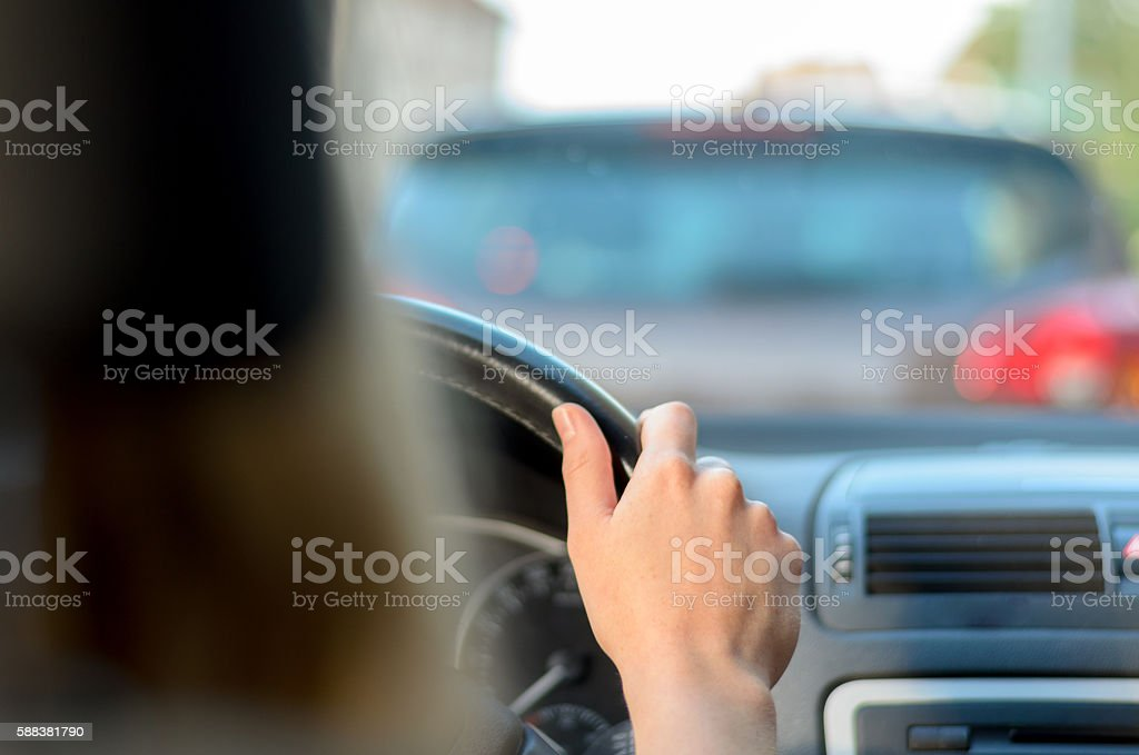 Young woman driving in traffic stock photo