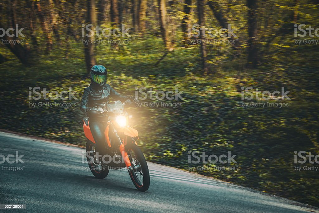 Young woman driving motorcycle stock photo