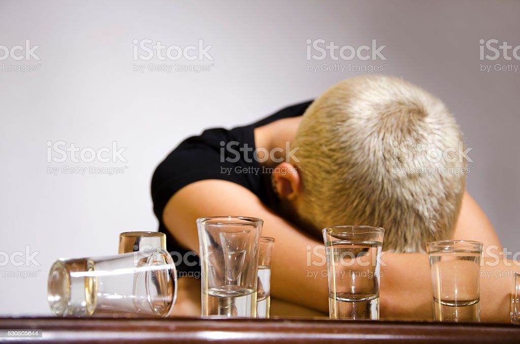 Young woman drunk, alcohol overdose stock photo