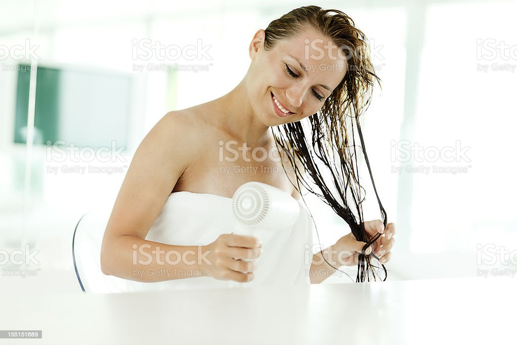 Young Woman Drying Her Hair stock photo