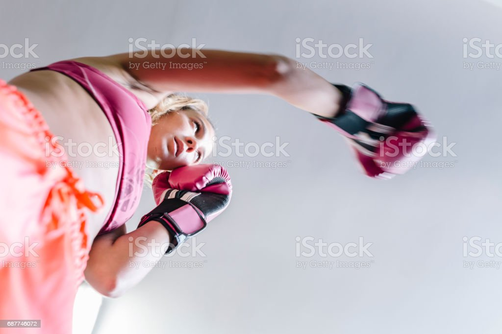 Young woman during boxing training stock photo