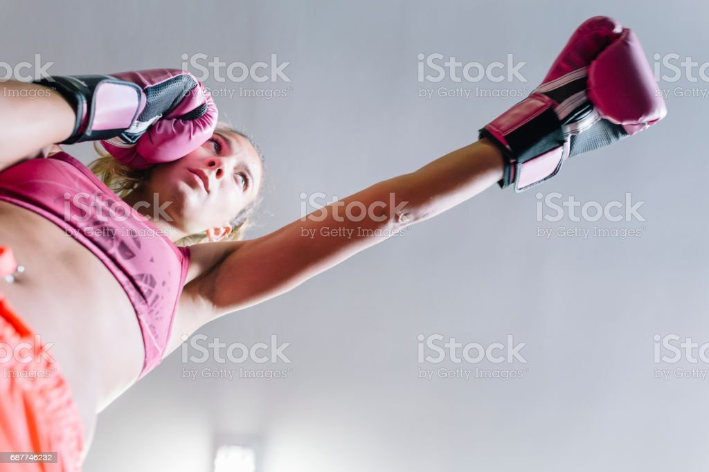 Young woman during boxing workout stock photo