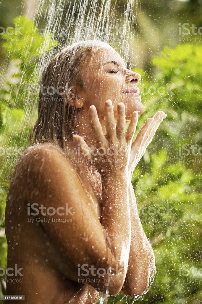 Young woman during showering outdoor. royalty-free stock photo