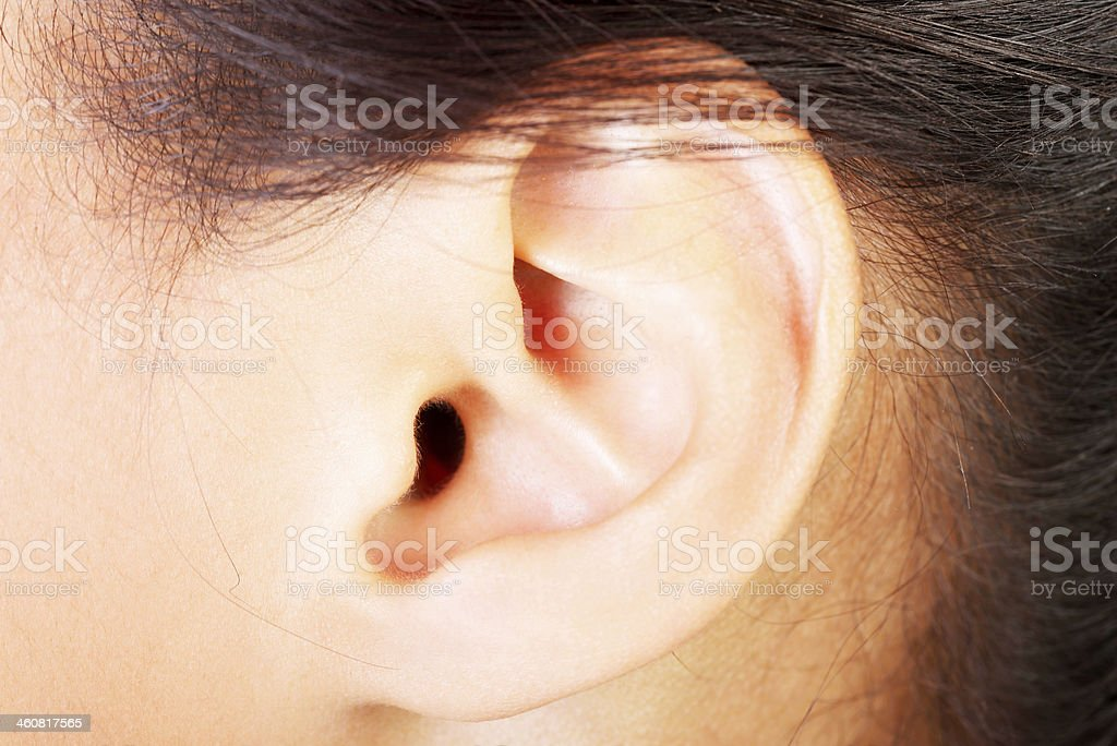 Young woman ear stock photo