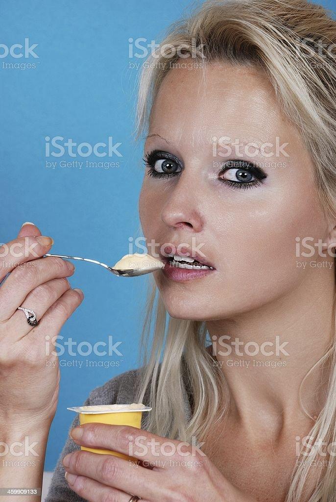young woman eatin cream royalty-free stock photo