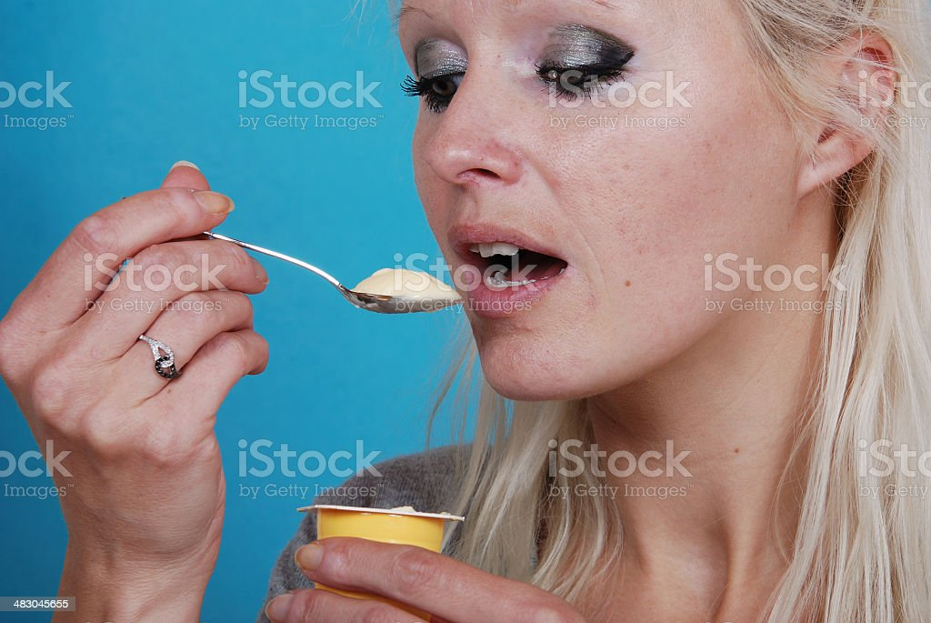 young woman eatin cream royalty-free stock photo