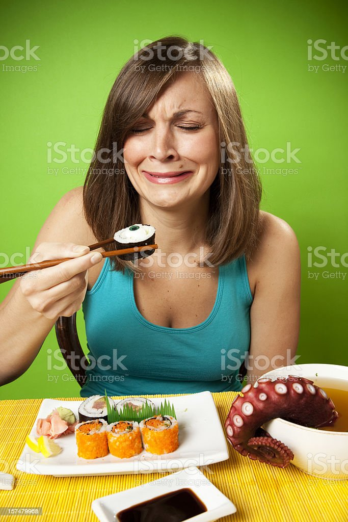 Young Woman Eating a Surreal Meal of Sushi royalty-free stock photo