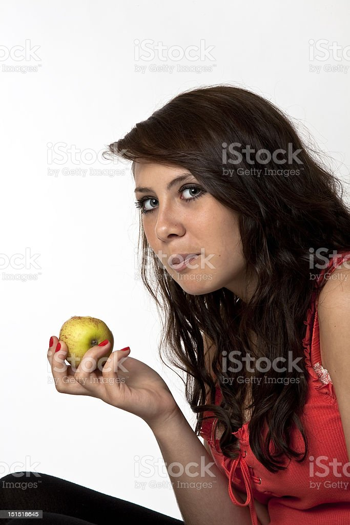 young woman eating apple stock photo